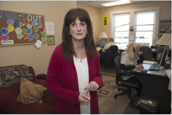 "Program Director Eileen Davis, who launched Call2Talk in December of 2013, says a huge increase in calls fielded has put the Framingham organization at a ""tipping point"" in need of additional volunteers and funding [Daily News and Wicked Local Staff Photo / Art Illman]"